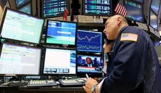 Akcje na Wall Street id� w g�r�. Sp�ki pozytywnie zaskakuj� wynikami